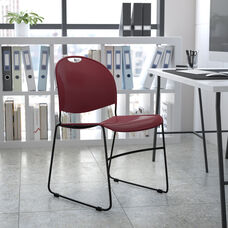 HERCULES Series 880 lb. Capacity Burgundy Ultra-Compact Stack Chair with Black Powder Coated Frame